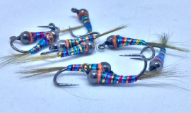 Black Tungsten Perdigon Rainbow orange spot